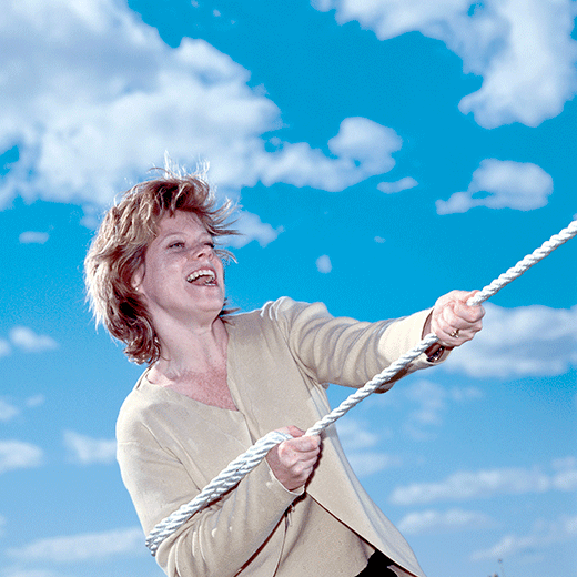 Photo of woman pulling a rope