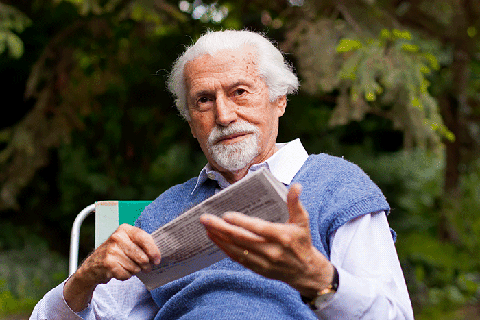 Photo of older man reading a newspaper